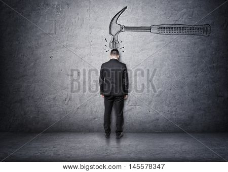 Big hand drawn hammer hitting a businessman on his head. Problems at work. Difficulties and troubles. Misfortune and calamity. Business staff.