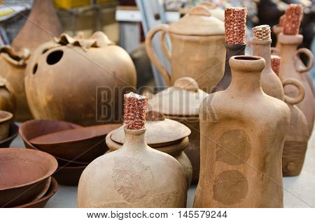 Showcases clay vessels bottles jugs and bowls