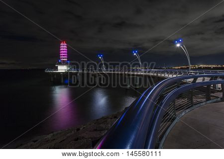 Brant Street Pier located in Burlington Ontario. Taken at night showing off its LED colour display during the summer.