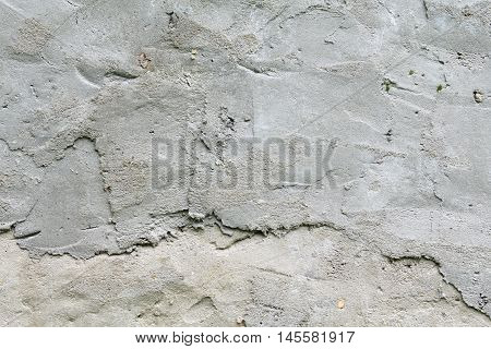The texture of the concrete wall, wattle and daub plaster gray