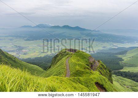 Mountain road around Mt.Aso in Kumamoto Japan .