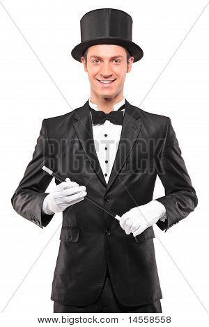 A Magician Holding A Magic Wand And Posing