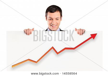 Smiling Businessman Holding A White Panel With A Growth Graph