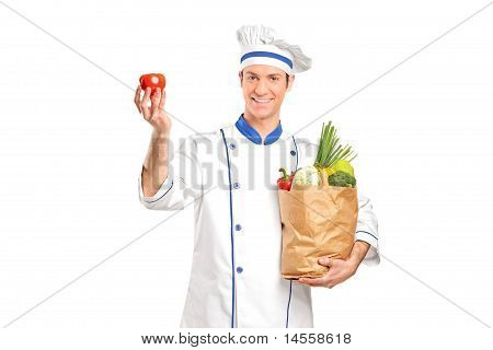 Chef Holding A Tomato And Grocery Bag Full With Vegetables