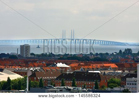 The bridge over Oresund between Copenhagen Denmark and Malmo Sweden Oresundsbron in a foggy landscape