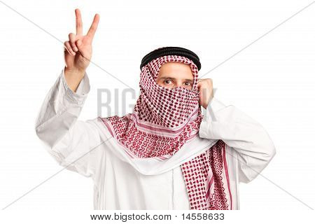 Arab Man With Covered Face Gesturing Victory