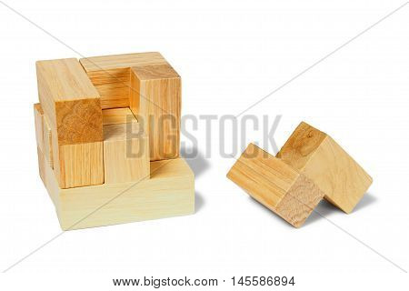 Cube - wooden logic puzzle on white background