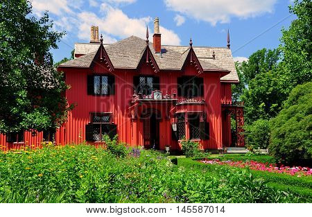 Woodstock Connecticut - July 11 2015: 1846 Roseland Cottage built in the Gothic Revival style for NYC businessman Henry Bowen and boxwood and flower gardens