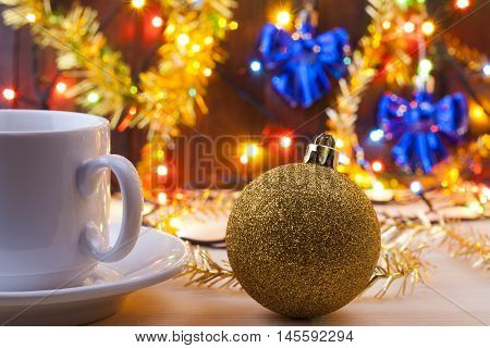 Mug With A Cup In The New Year's Table. Christmas Still Life. New Year's Toys On The Table.