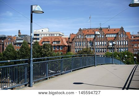 A footbridge over the Weser River with views of the old town and waterfront.