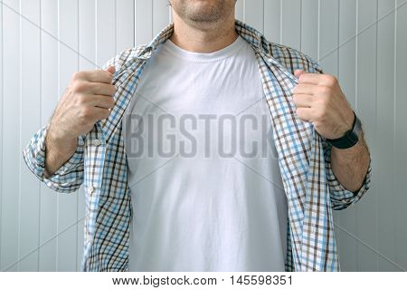 Guy revealing white t-shirt as copy space for mock up graphic design