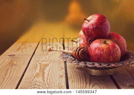 Apple and honey on wooden table for jewish Rosh hashana (new year) celebration