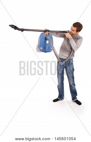 Boy holding a vacuum cleaner and takes aim isolated on white background