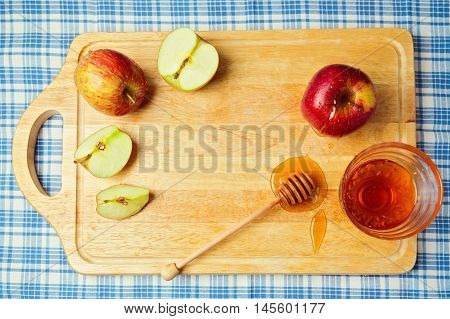 Apple and honey on wooden board. Jewish Rosh hashana (new year) celebration. View from above