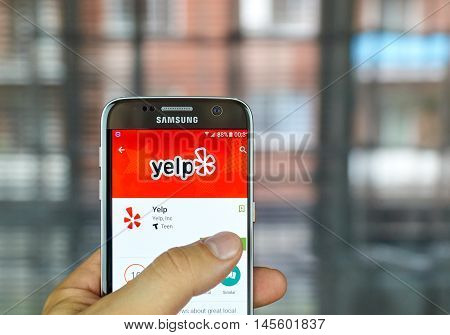 MONTREAL CANADA - August 8 2016 - Yelp mobile app on screen of Samsung S7 in hand. Yelp is a crowd-sourced local business review and social networking site and company.