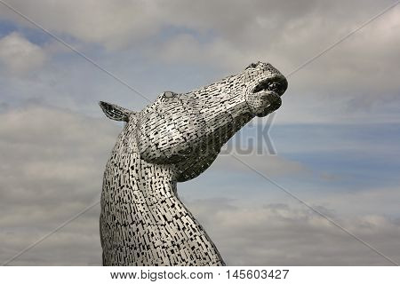 Falkirk, Scotland - August 15, 2016: The Kelpies sculpture designed by Andy Scot rise above Helix Park.