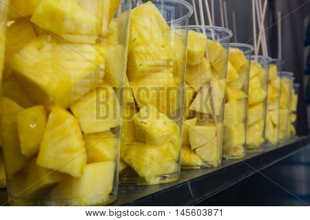 Abstract Bright Yellow Pineapple Fruit in Cups