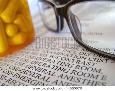 Closeup Of Medical Bill And Pills
