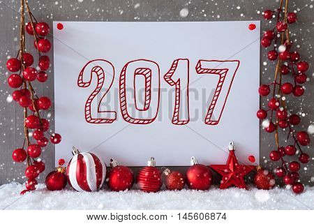 Label With Text 2017 For Happy New Year. Red Christmas Decoration Like Balls On Snow. Urban And Modern Cement Wall As Background With Snowflakes.