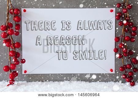 Label With English Quote There Is Always A Reason To Smile. Red Christmas Decoration On Snow. Urban And Modern Cement Wall As Background With Snowflakes.