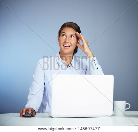 Beautiful Brown Haired Businesswoman With Laptop Forgot Or Thinks About Something