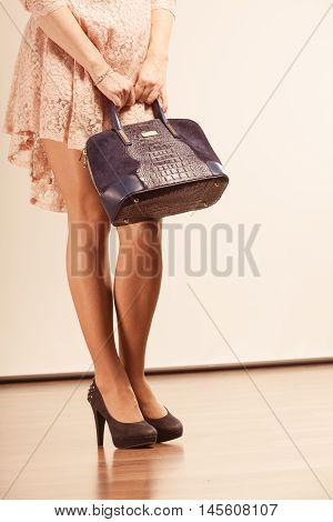 Female With Nice Legs Holding Handbag.