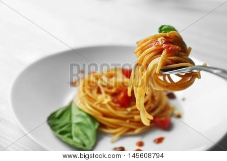 Fork with tasty pasta, close up