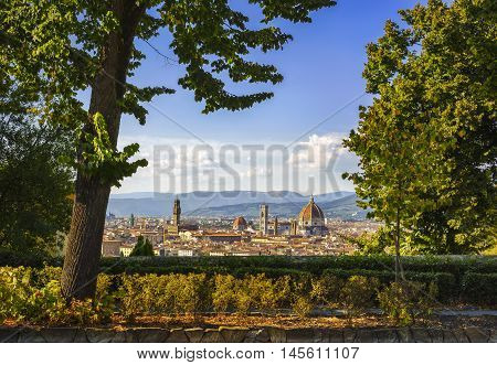 Florence or Firenze sunset aerial cityscape and public garden. Palazzo Vecchio and Duomo Cathedral. Tuscany Italy