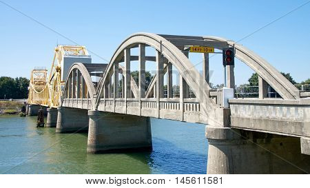 Isleton CA - August 06 2016: Isleton Bridge a historic bascule bridge carrying California State Route 160 across the Sacramento River north of Isleton California built in 1923.