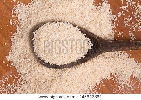 Farinha de Mandioca. Manioc. Cassava flour over a wooden table