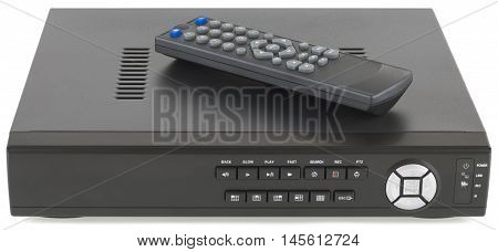 Network digital video recorder and remote control isolated on white background