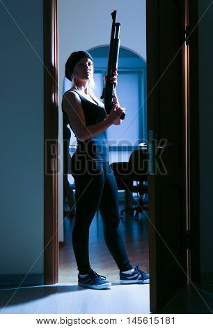 Armed thief entering a house