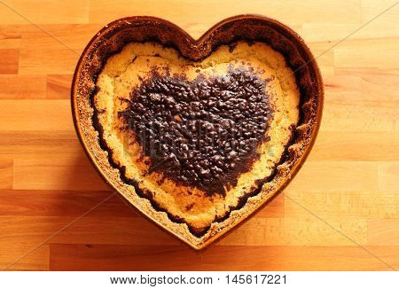 Sweet heart. Cheese cake with chocolate in ceramic pan as a heart. Traditional Valentine or wedding sweets from Czech Republic (Central Europe). Tasty gift for your sweetheart.