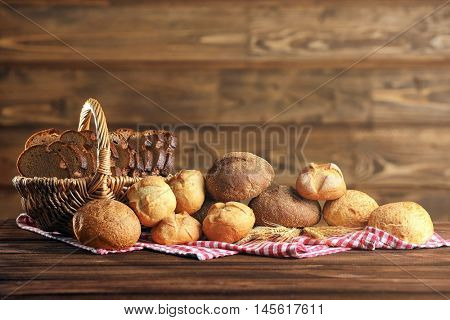 Bread and a variety of fresh bap on a checkered napkin