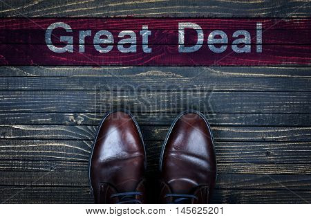 Great Deal message and business shoes on wooden floor