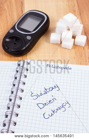 Polish Inscription World Diabetes Day In Notebook, Glucometer And Sugar Cubes