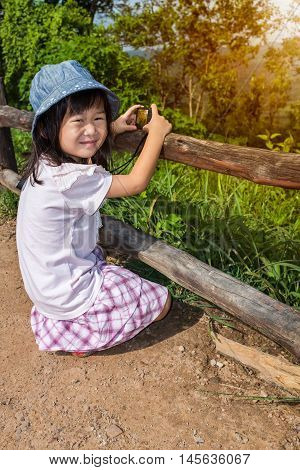 Happy Asian Girl Smiling And Relaxing Outdoors In The Daytime, Travel On Vacation.