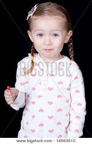 An excited girl with a lolli pop.