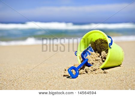Toy bucket and shovel on the beach