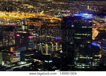 Melbourne Australia - August 27 2016: Aerial nightscape of the City with skyscrapers and glowing streetlights
