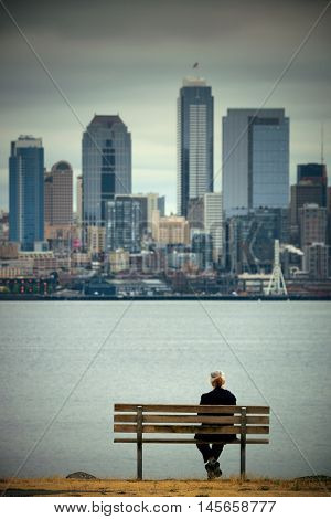 A lady rest at waterfront with Seattle city skyline