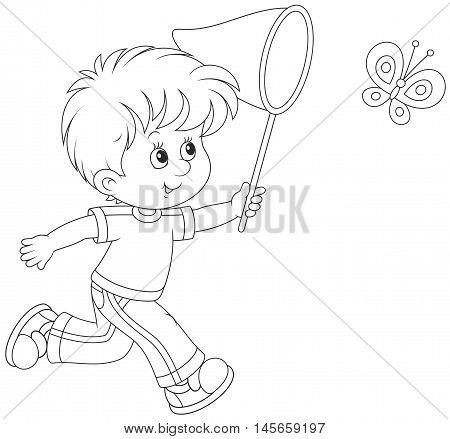 little boy running and catching a flying butterfly with a butterfly net