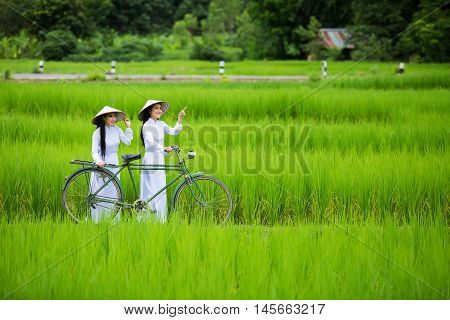 Beautiful woman with Vietnam culture traditional vintage styleHoi an Vietnam, Mu Cang Chai