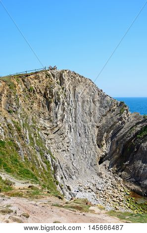 LULWORTH COVE, UNITED KINGDOM - JULY 19, 2016 - Rock formations along the coastline Lulworth Cove Dorset England UK Western Europe, July 19, 2016.