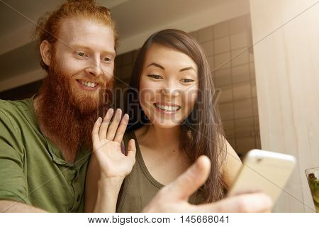 Young Cute Couple Recording Video For Congratulating Their Friend On His Birthday. Pretty Student Gi