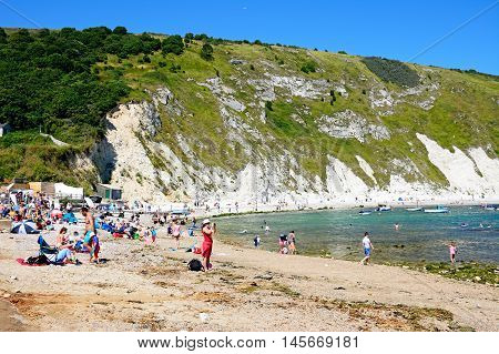 LULWORTH COVE, UNITED KINGDOM - JULY 19, 2016 - View of the beach and cove with holidaymakers enjoying the setting Lulworth Cove Dorset England UK Western Europe, July 19, 2016.