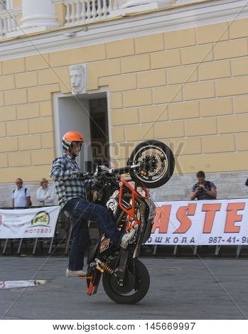 St. Petersburg, Russia - 12 August, The bike picked up on the back wheel,12 August, 2016. The annual International Festival of Motor Harley Davidson in St. Petersburg Ostrovsky Square.