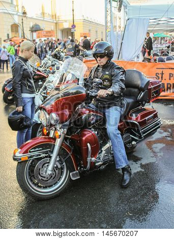 St. Petersburg, Russia - 12 August, Biker on a claret motorcycle,12 August, 2016. The annual International Festival of Motor Harley Davidson in St. Petersburg Ostrovsky Square.