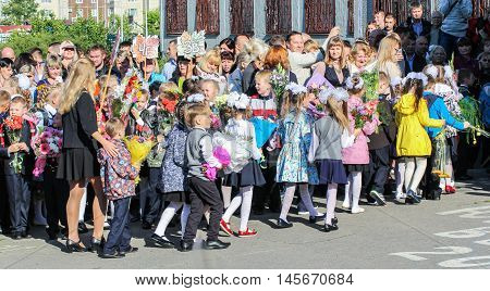 St. Petersburg, Russia - 1 September, First-graders with flowers escorted to school,1 September, 2016. School holiday the Day of Knowledge.