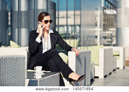Business woman on a coffee break, toned image